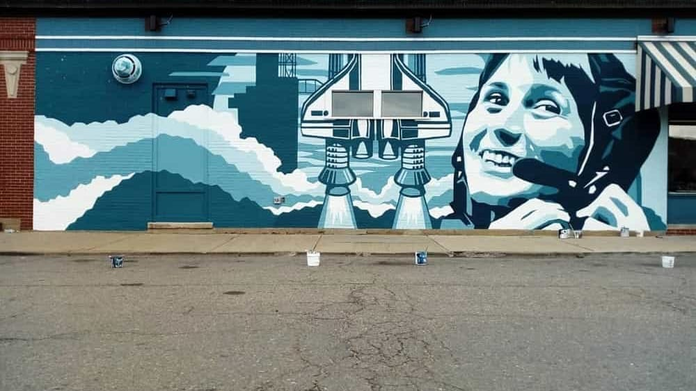Astrosamantha on a mural in Detroit